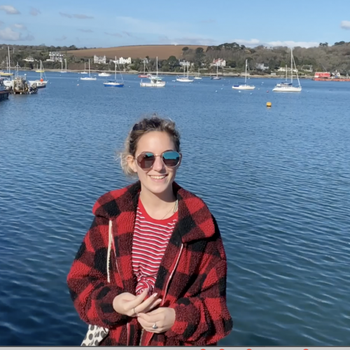 Picture of Amy Wood, student content creator and Ambassador, by the sea in Falmouth.