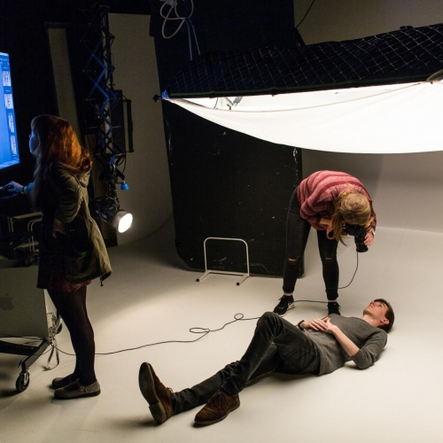 Photography students shooting in the photography studio
