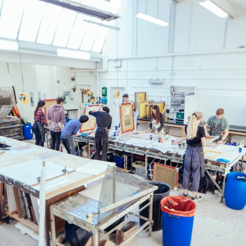 Students working in studio at a table